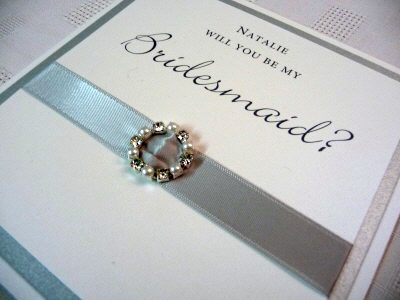 Silver and White Will you be my Bridesmaid card with a round diamante and pearl mixed fancy buckle