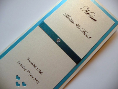 Ivory and turquoise triple mounted folded menu card with a heart theme
