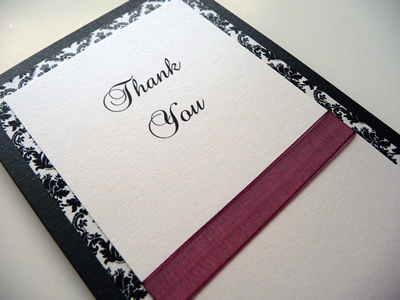 Black and white damask themed thank you cards with burgundy ribbon