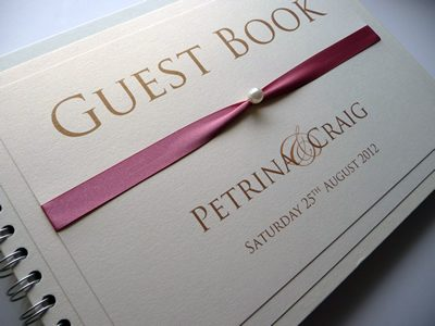 Dusky pink and ivory wedding guest book with a pearl detail