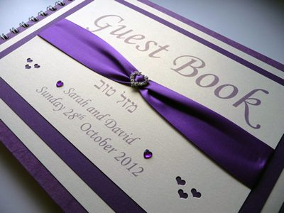 Purple and Ivory heart theme wedding guest book with a diamante heart buckle