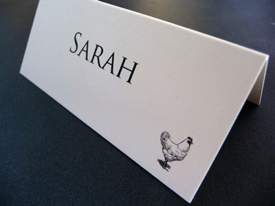 Simple folded placecards with an animal image depicting menu choice