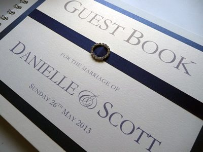 Navy and Ivory Wedding Guest Book with a round diamante ribbon buckle