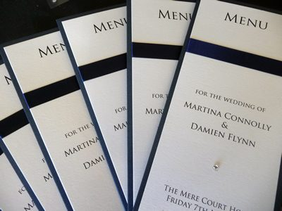 Navy and ivory folded menu with flat ribbon