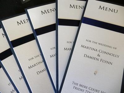 Navy and ivory folded menu with flat ribbon