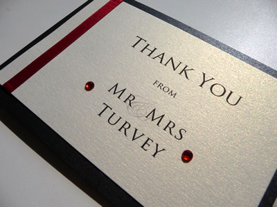Red and black folded thank you card