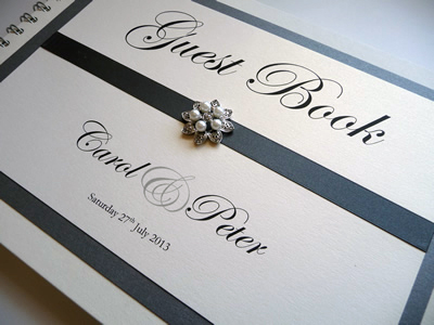Charcoal grey wedding guest book with a fancy embellishment
