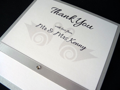Silver and white thank you card with a swan theme