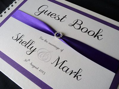 Purple and Ivory Wedding Guest Book with a round diamante ribbon buckle