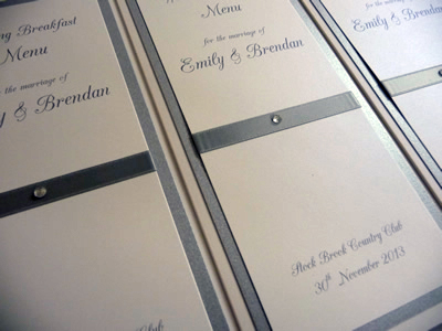 Silver and ivory triple mounted folded menu cards