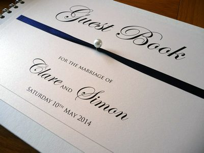 Classic wedding guest book with a pearl detail