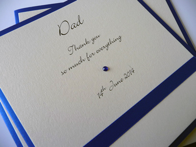 Purple and Ivory folded Bridal Party thank you cards with purple satin ribbon laid flat