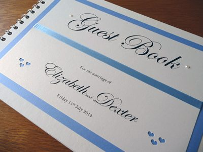 Cornflower Blue guest book with a heart theme