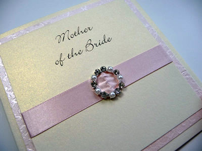 Pink and Ivory Bridal Party thank you card with a round diamante and pearl mixed fancy buckle