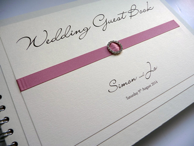 Ivory and Dusky pink guest book with a round diamante buckle