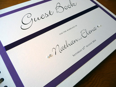 Purple themed wedding guest book