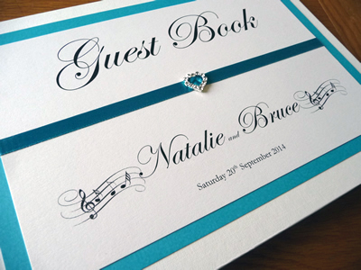 Teal and ivory wedding guest book with a music theme