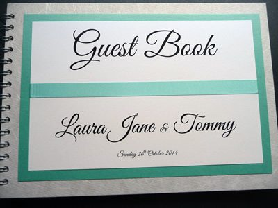 White and Aqua Wedding Guest Book with flat ribbon