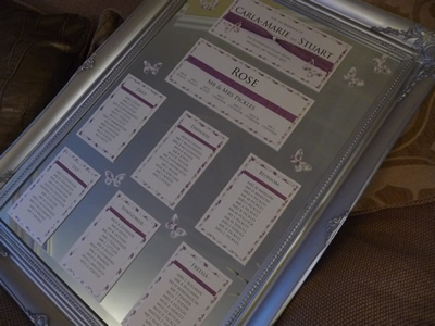 Table Plan cards for a mirror with a plum coloured patterned paper and butterflies