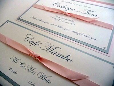 Pink and Silver Wedding Table Plan with knotted pink satin ribbon detailing