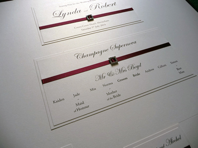 Ivory Wedding Table Plan with Burgundy ribbon and square diamante ribbon buckles