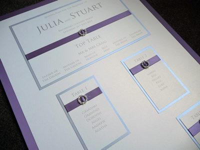 Purple and Ivory Table Plan board with fancy round diamante and pearl ribbon buckles