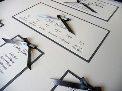 Ivory and Charcoal themed Table Plan with satin ribbon bows
