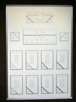Ivory and Silver Table Plan with interlocked hearts and diagonal ribbon detail