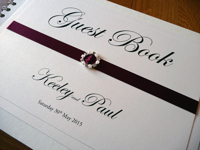 Burgundy and Ivory Wedding Guest Book with a fancy diamante and pearl ribbon buckle