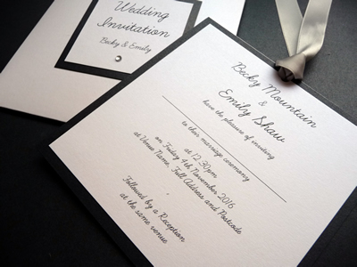 Black and White Wallet wedding invitation with silver satin ribbon with a clear round diamante