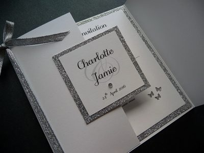 Silver Glitter and White Gatefold invitation with a butterfly theme and a bow
