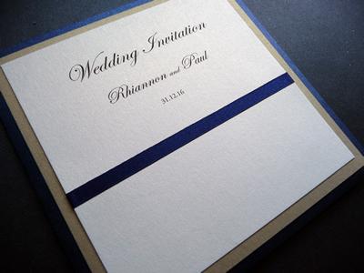 Navy blue and gold pocketcard wedding invitations with satin ribbon