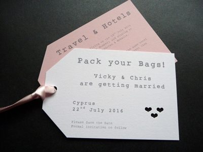 Luggage Tag style Wedding Invitation with a pink colour scheme and heart theme