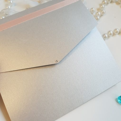 Silver pocketfold wedding invitation with classic pink satin ribbon and a diamante detail