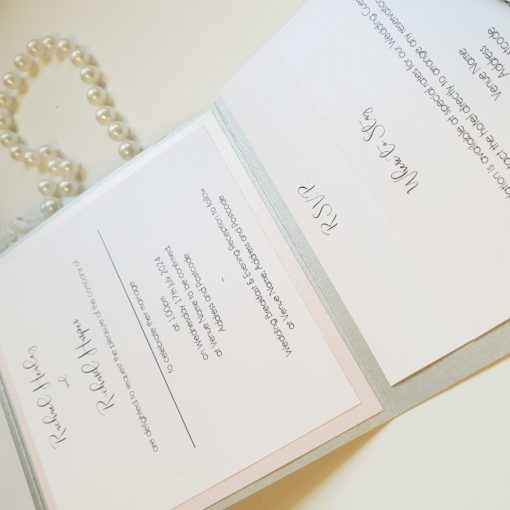 Silver portrait pocketfold with a blush pink colour scheme and loose inserts inside