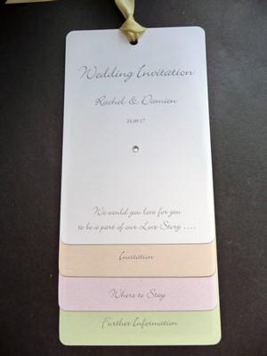 Pastel themed loop tied wedding invitation