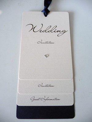 Ivory and Navy Loop Tied wedding invitations