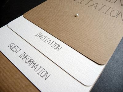Rustic loop tied wedding invitations with twine