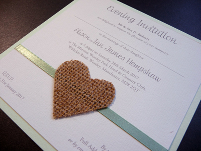 Evening invitations with mint green ribbon and hessian heart