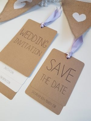 Rustic Loop Tied wedding invitations with lilac ribbon