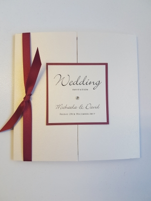 Red and Ivory gatefold invitation with knotted red ribbon