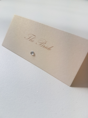 Ivory pearlised folded placecard with a diamante