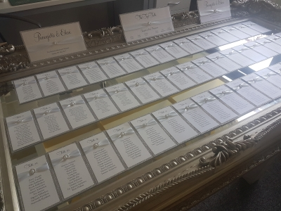 Silver Glitter and White Table Plan Cards with buckles - perfect for a mirror