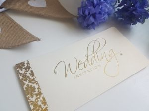 Damask Themed Gold Foiled and Ivory Pearlised Cheque Book Wedding Invitation