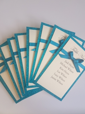 Teal Glitter and Ivory Table Plan Cards with flat ribbon and bows