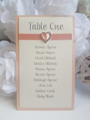 Coral and Ivory Table Plan Cards with heart shaped diamante buckles