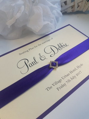 Purple and Ivory Table Plan Cards with diamond shaped diamante buckles