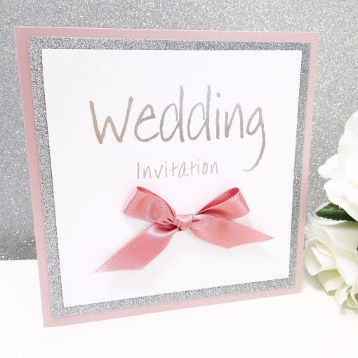 Dusky Pink and Silver glitter themed Pocketcard style wedding invitations with a big bow and foiled wording