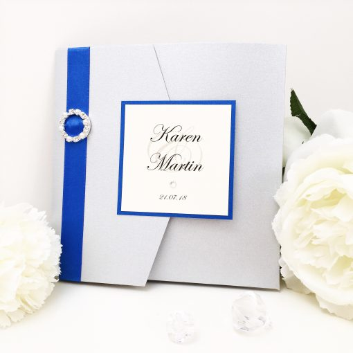 Silver & Royal Blue Fancy Pocketfold Wedding Invitation with a plaque and ribbon buckle