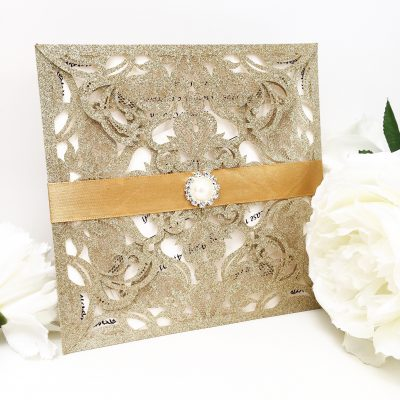 Laser Cut Wedding Invitations with gold glitter and gold ribbon detail